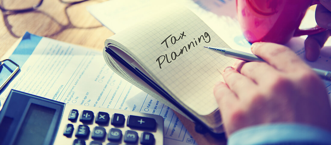 Tax planning written in notebook
