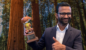Thumbnail of Manoj holding the Appy Award