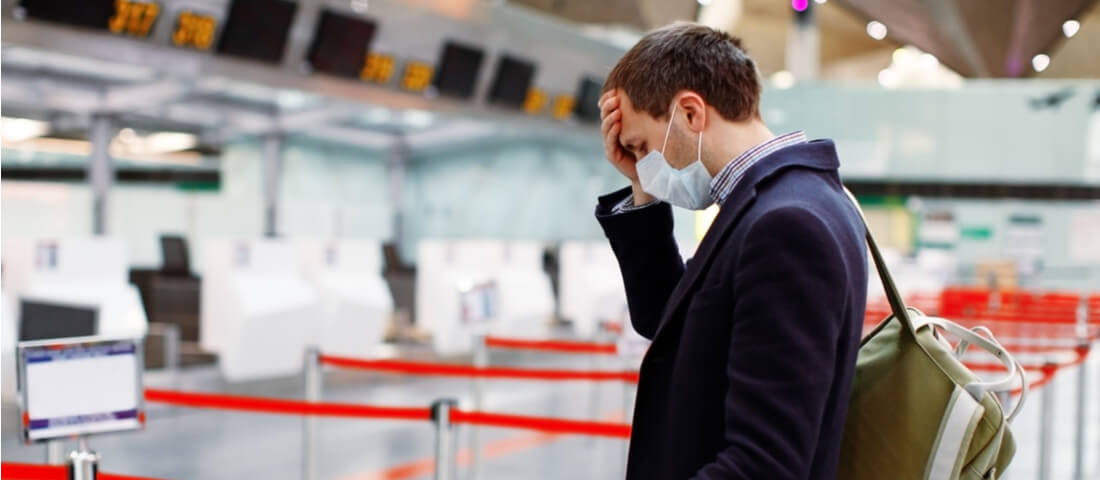 Man at airport with mask