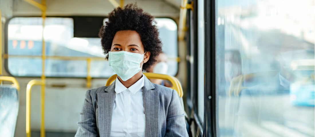 Image of a woman in a mask on a bus