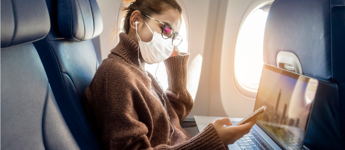 Woman in mask on a flight