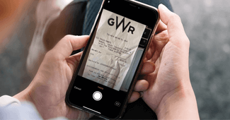 Man looking at receipt on phone