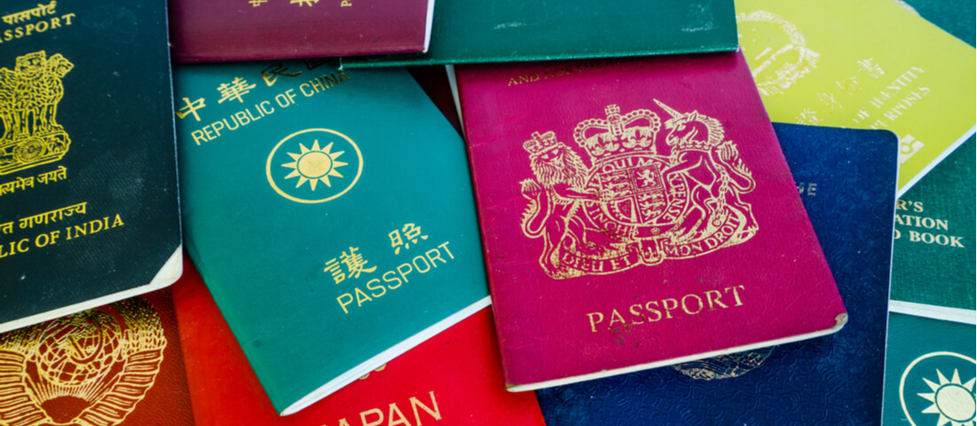 Image showing pile of passports from all over the world