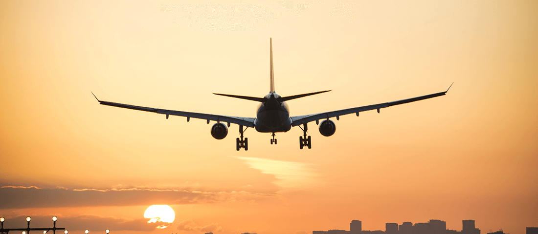 Plane landing in sunset